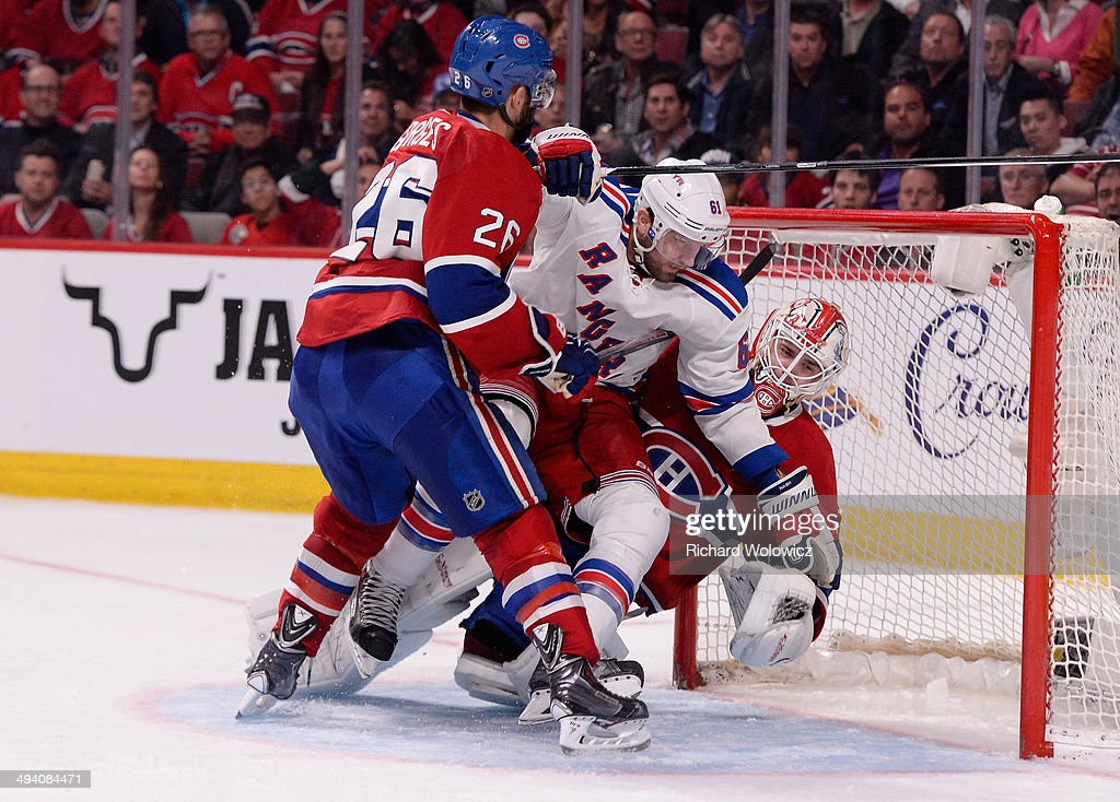 <a gi-track='captionPersonalityLinkClicked' href=/galleries/search?phrase=Rick+Nash&family=editorial&specificpeople=202196 ng-click='$event.stopPropagation()'>Rick Nash</a> #61 of the New York Rangers crashes into <a gi-track='captionPersonalityLinkClicked' href=/galleries/search?phrase=Dustin+Tokarski&family=editorial&specificpeople=4594196 ng-click='$event.stopPropagation()'>Dustin Tokarski</a> #35 of the Montreal Canadiens during Game Five of the Eastern Conference Final in the 2014 NHL Stanley Cup Playoffs at Bell Centre on May 27, 2014 in Montreal, Canada.