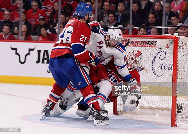 Rick Nash of the New York Rangers crashes into Dustin Tokarski of the Montreal Canadiens during Game Five of the Eastern Conference Final in the 2014...
