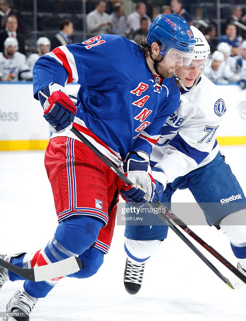 <a gi-track='captionPersonalityLinkClicked' href=/galleries/search?phrase=Rick+Nash&family=editorial&specificpeople=202196 ng-click='$event.stopPropagation()'>Rick Nash</a> #61 of the New York Rangers faces-off against Richard Panik #71 of the Tampa Bay Lightning at Madison Square Garden on February 28, 2013 in New York City.