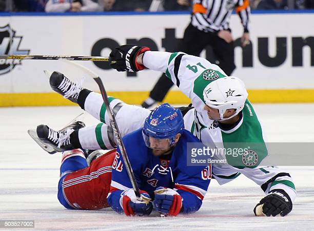 Rick Nash of the New York Rangers gets under Jamie Benn of the Dallas Stars during the second period at Madison Square Garden on January 5 2016 in...