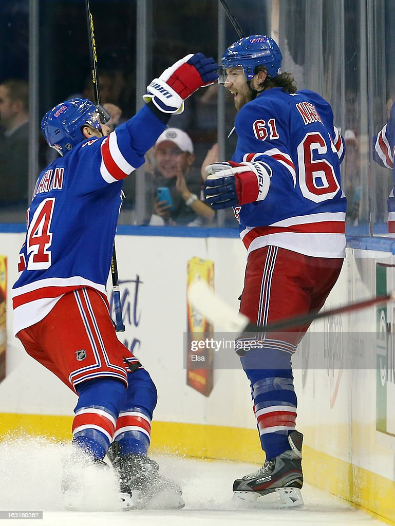 Rick Nash of the New York Rangers is congratulated by teammates Ryan Callahan after Nash scored in the third period against the Philadelphia Flyers...