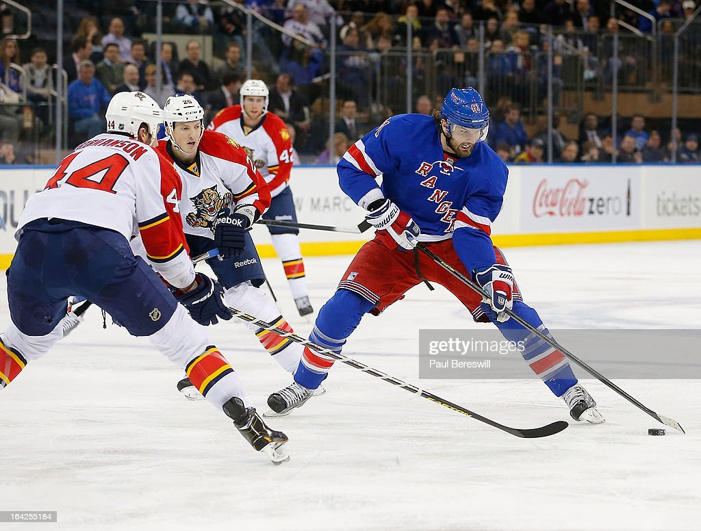 <a gi-track='captionPersonalityLinkClicked' href=/galleries/search?phrase=Rick+Nash&family=editorial&specificpeople=202196 ng-click='$event.stopPropagation()'>Rick Nash</a> #61 of the New York Rangers is defended by <a gi-track='captionPersonalityLinkClicked' href=/galleries/search?phrase=Erik+Gudbranson&family=editorial&specificpeople=5741800 ng-click='$event.stopPropagation()'>Erik Gudbranson</a> #44 of the Florida Panthers and his teammates during the second period of an NHL hockey game at Madison Square Garden on March 21, 2013 in New York City. Panthers won 3-1.