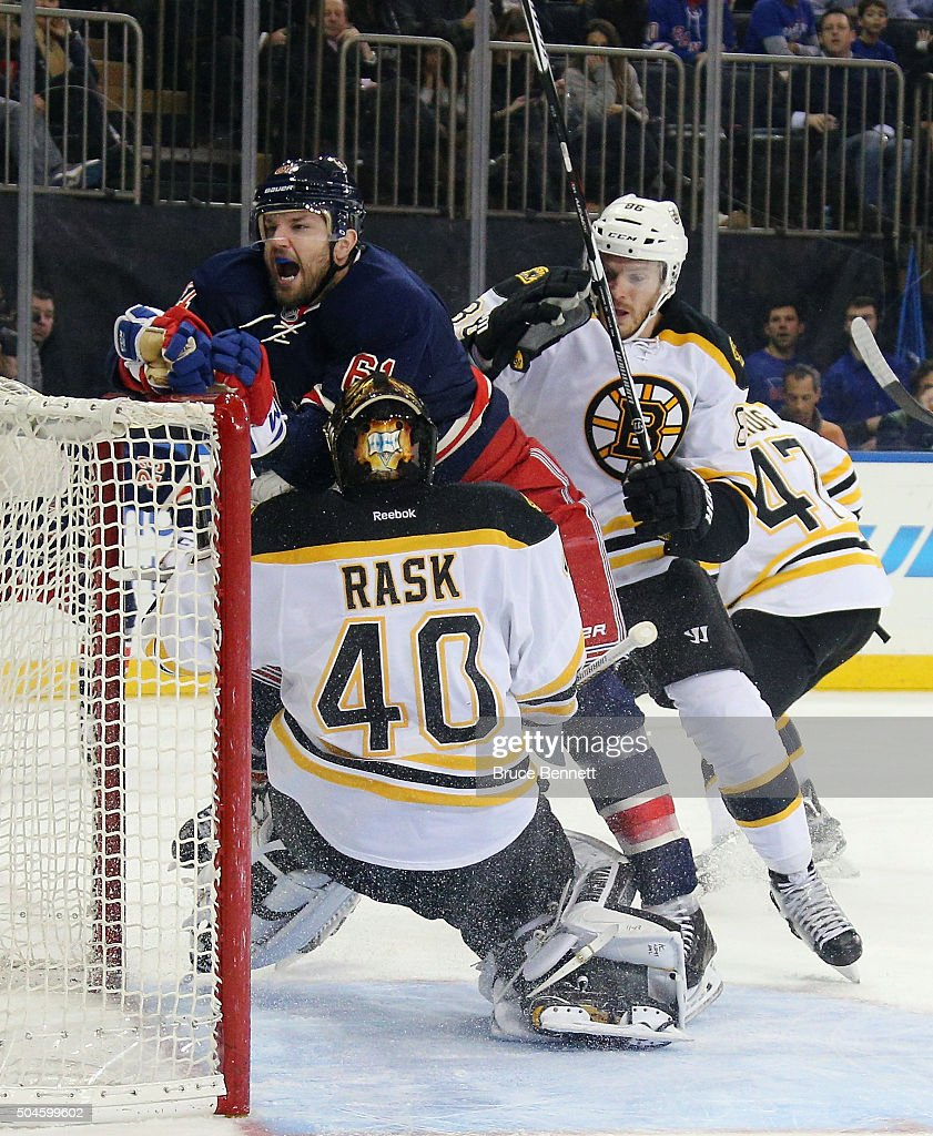 <a gi-track='captionPersonalityLinkClicked' href=/galleries/search?phrase=Rick+Nash&family=editorial&specificpeople=202196 ng-click='$event.stopPropagation()'>Rick Nash</a> #61 of the New York Rangers is pushed into <a gi-track='captionPersonalityLinkClicked' href=/galleries/search?phrase=Tuukka+Rask&family=editorial&specificpeople=716723 ng-click='$event.stopPropagation()'>Tuukka Rask</a> #40 by defenseman <a gi-track='captionPersonalityLinkClicked' href=/galleries/search?phrase=Kevan+Miller&family=editorial&specificpeople=8236132 ng-click='$event.stopPropagation()'>Kevan Miller</a> #86 of the Boston Bruins at Madison Square Garden on January 11, 2016 in New York City.