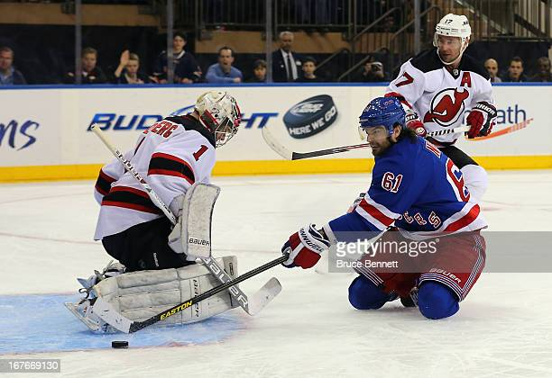 Rick Nash of the New York Rangers is stopped by Johan Hedberg of the New Jersey Devils during the second period at Madison Square Garden on April 27...