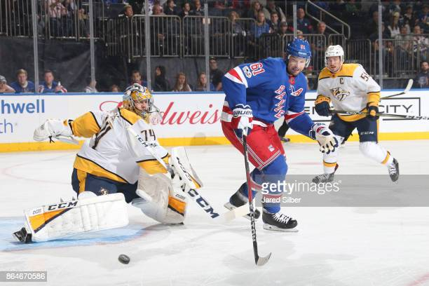 Rick Nash of the New York Rangers looks to collect the loose puck after a save by Juuse Saros of the Nashville Predators at Madison Square Garden on...