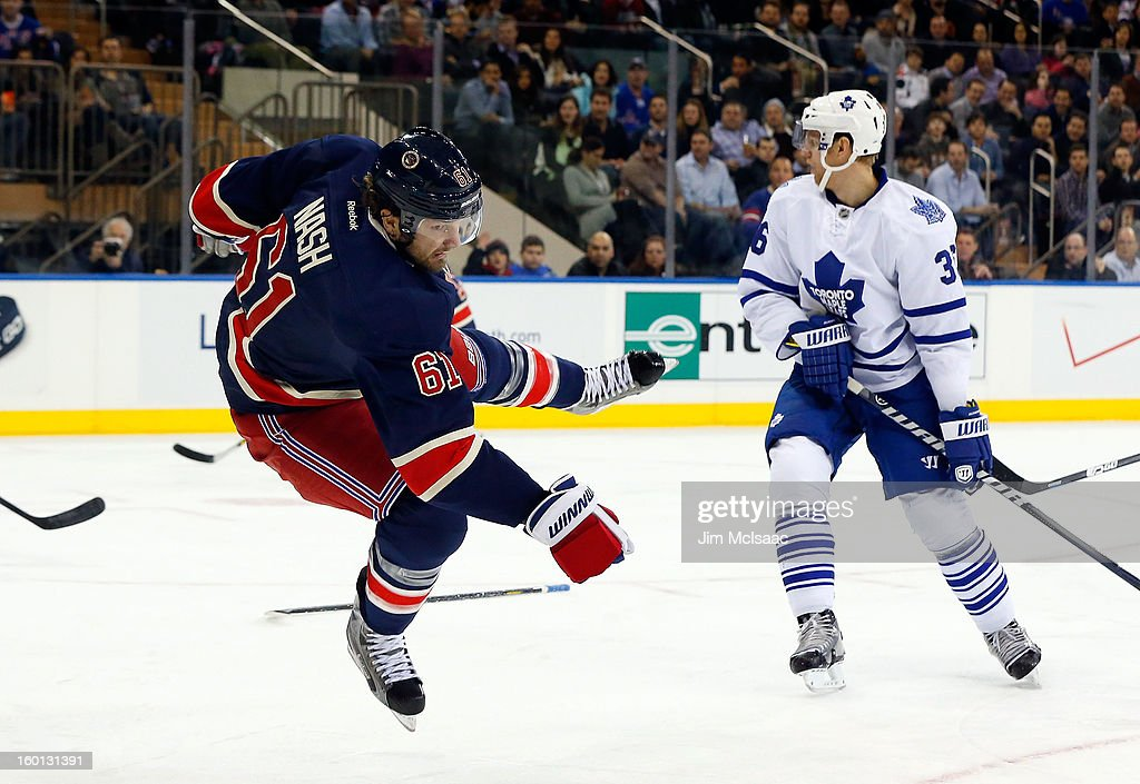 <a gi-track='captionPersonalityLinkClicked' href=/galleries/search?phrase=Rick+Nash&family=editorial&specificpeople=202196 ng-click='$event.stopPropagation()'>Rick Nash</a> #61 of the New York Rangers loses his balance after a collision with <a gi-track='captionPersonalityLinkClicked' href=/galleries/search?phrase=Carl+Gunnarsson&family=editorial&specificpeople=5557315 ng-click='$event.stopPropagation()'>Carl Gunnarsson</a> #36 of the Toronto Maple Leafs at Madison Square Garden on January 26, 2013 in New York City.