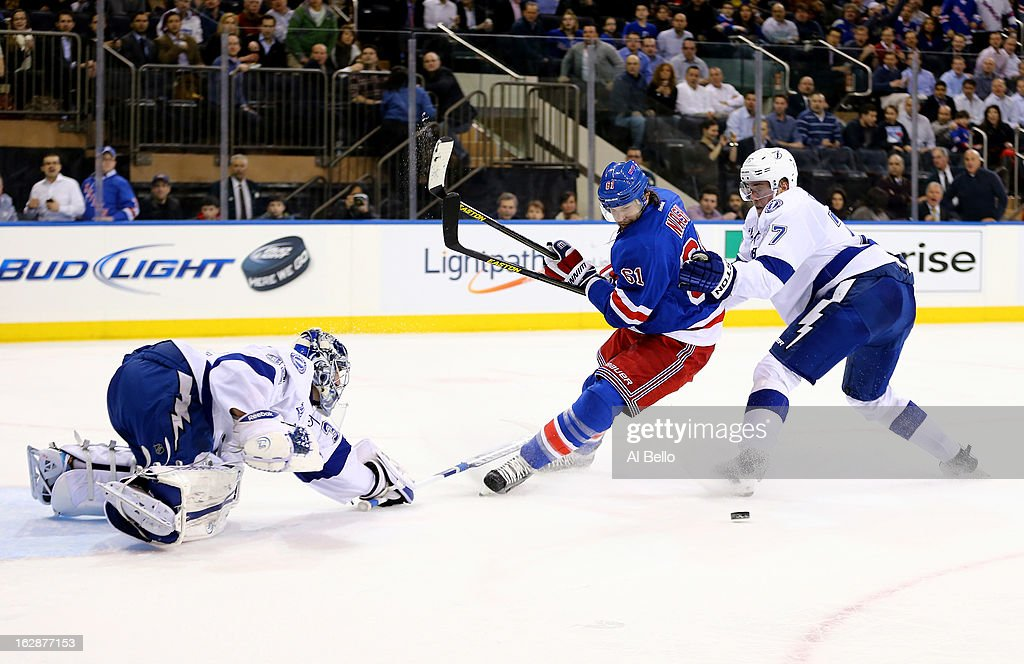 <a gi-track='captionPersonalityLinkClicked' href=/galleries/search?phrase=Rick+Nash&family=editorial&specificpeople=202196 ng-click='$event.stopPropagation()'>Rick Nash</a> #61 of the New York Rangers misses the puck against <a gi-track='captionPersonalityLinkClicked' href=/galleries/search?phrase=Mathieu+Garon&family=editorial&specificpeople=206119 ng-click='$event.stopPropagation()'>Mathieu Garon</a> #32 of the Tampa Bay Lightning Alex Killorn #17 of the Tampa Bay Lightning defends during their game at Madison Square Garden on February 28, 2013 in New York City.