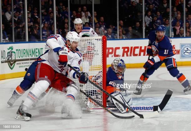 Rick Nash of the New York Rangers misses the wraparound attempt against Evgeni Nabokov of the New York Islanders at the Nassau Veterans Memorial...