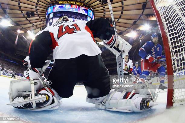 Rick Nash of the New York Rangers moves in on Craig Anderson of the Ottawa Senators in Game Three of the Eastern Conference Second Round during the...
