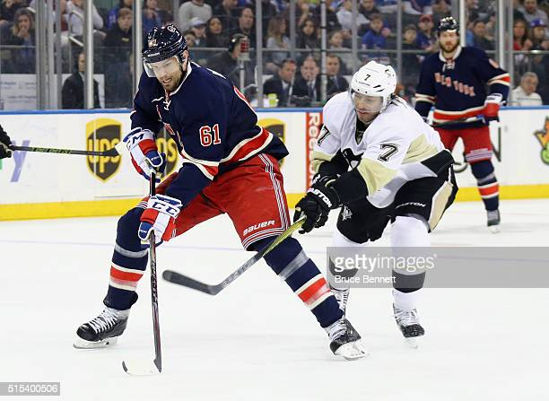 Rick Nash of the New York Rangers moves past Matt Cullen of the Pittsburgh Penguins during the second period at Madison Square Garden on March 13...