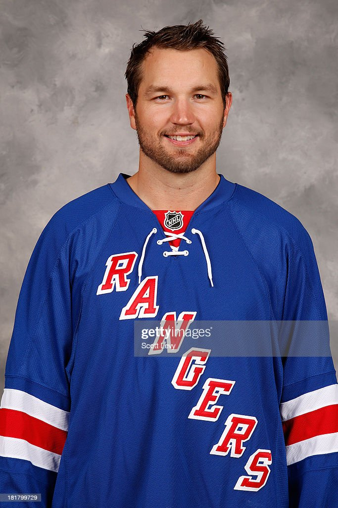 <a gi-track='captionPersonalityLinkClicked' href=/galleries/search?phrase=Rick+Nash&family=editorial&specificpeople=202196 ng-click='$event.stopPropagation()'>Rick Nash</a> of the New York Rangers poses for his official headshot for the 2013-2014 season on September 11, 2013 in White Plains, New York.