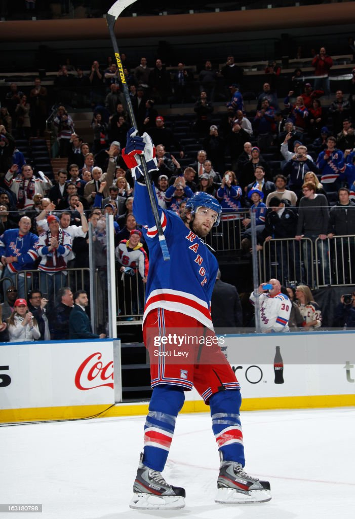Rick Nash #61 of the New York Rangers salutes his fans as the number one star of the game against the Philadelphia Flyers at Madison Square Garden on March 5, 2013 in New York City. The Rangers defeat the Flyers 4-2.