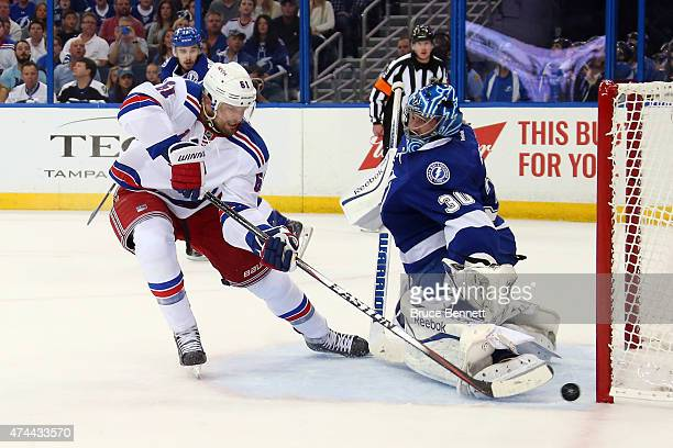 Rick Nash of the New York Rangers scores a goal during the first period against Ben Bishop of the Tampa Bay Lightning in Game Four of the Eastern...