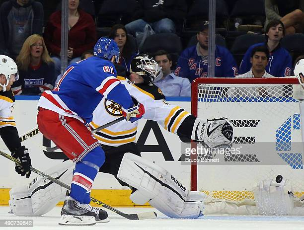 Rick Nash of the New York Rangers scores a third period goal against Jonas Gustavsson of the Boston Bruins at Madison Square Garden on September 30...