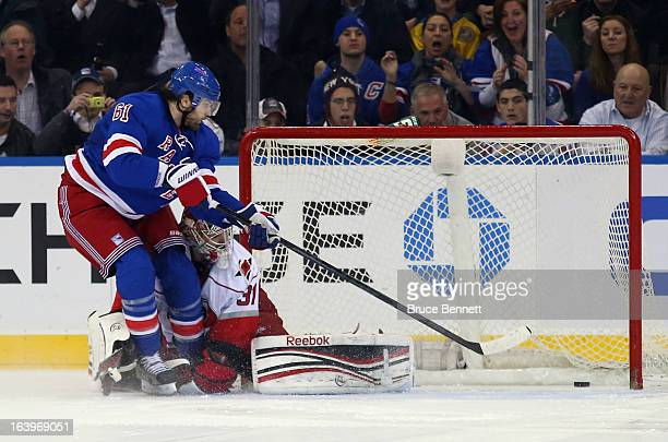 Rick Nash of the New York Rangers scores the shootout winning goal past Dan Ellis of the Carolina Hurricanes at Madison Square Garden on March 18...