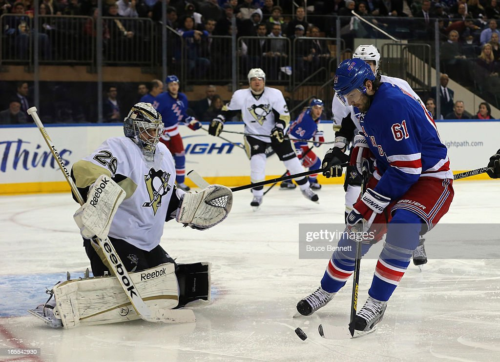 <a gi-track='captionPersonalityLinkClicked' href=/galleries/search?phrase=Rick+Nash&family=editorial&specificpeople=202196 ng-click='$event.stopPropagation()'>Rick Nash</a> #61 of the New York Rangers shoots on <a gi-track='captionPersonalityLinkClicked' href=/galleries/search?phrase=Marc-Andre+Fleury&family=editorial&specificpeople=233779 ng-click='$event.stopPropagation()'>Marc-Andre Fleury</a> #29 of the Pittsburgh Penguins at Madison Square Garden on April 3, 2013 in New York City.