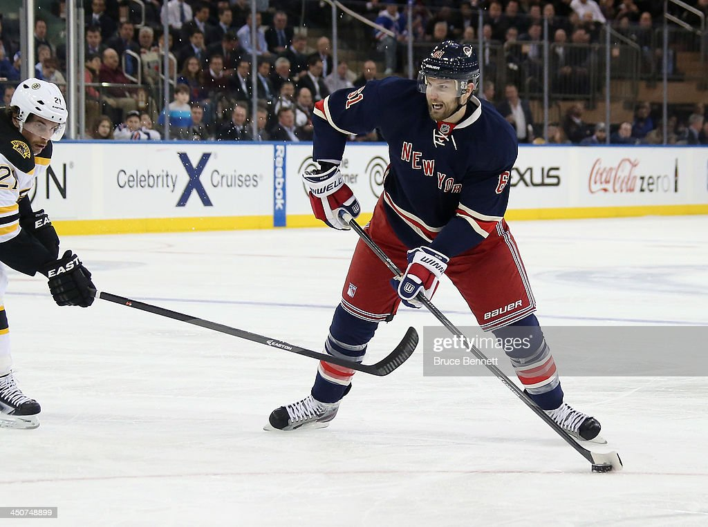 <a gi-track='captionPersonalityLinkClicked' href=/galleries/search?phrase=Rick+Nash&family=editorial&specificpeople=202196 ng-click='$event.stopPropagation()'>Rick Nash</a> #61 of the New York Rangers skates against the Boston Bruins at Madison Square Garden on November 19, 2013 in New York City. The Bruins defeated the Rangers 2-1.