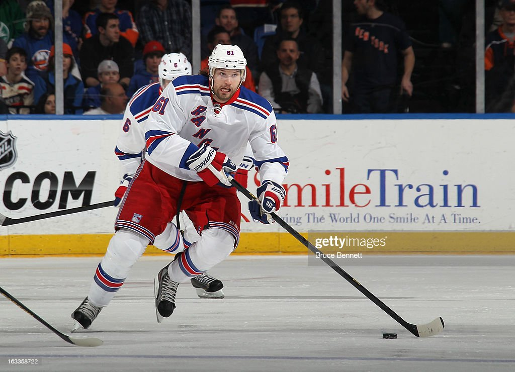 Rick Nash #61 of the New York Rangers skates against the New York Islanders at the Nassau Veterans Memorial Coliseum on March 7, 2013 in Uniondale, New York. The Rangers defeated the Islanders 2-1 in overtime.