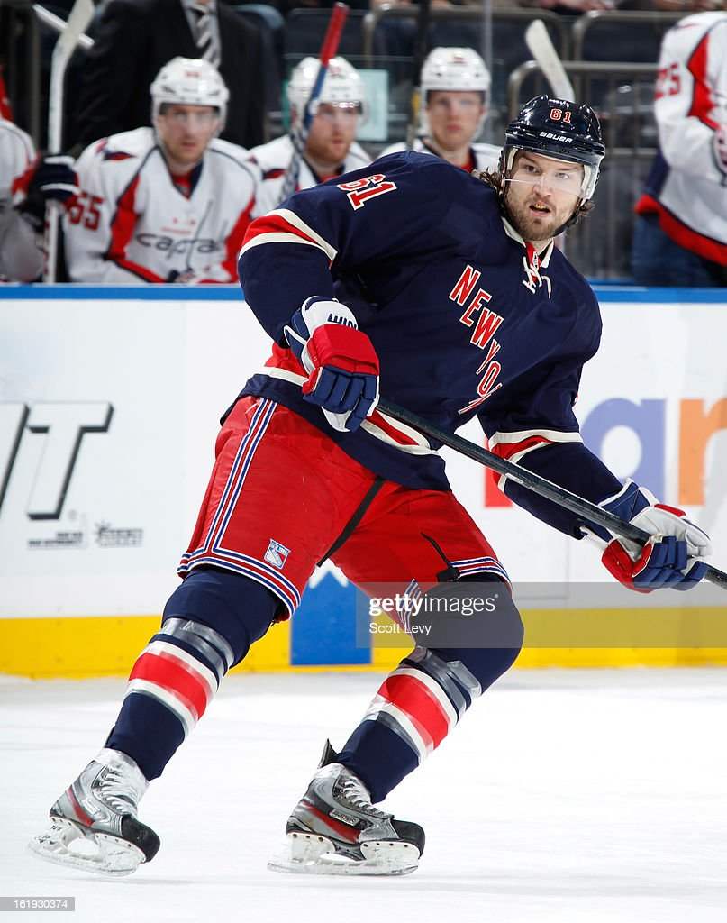 <a gi-track='captionPersonalityLinkClicked' href=/galleries/search?phrase=Rick+Nash&family=editorial&specificpeople=202196 ng-click='$event.stopPropagation()'>Rick Nash</a> #61 of the New York Rangers skates against the Washington Capitals at Madison Square Garden on February 17, 2013 in New York City. The Rangers defeat the Capitals 2-1.