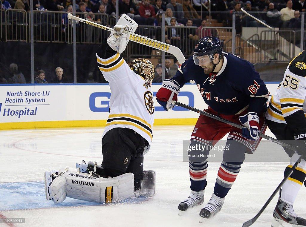 Rick Nash #61 of the New York Rangers skates against Tuukka Rask #40 of the Boston Bruins at Madison Square Garden on November 19, 2013 in New York City. The Bruins defeated the Rangers 2-1.
