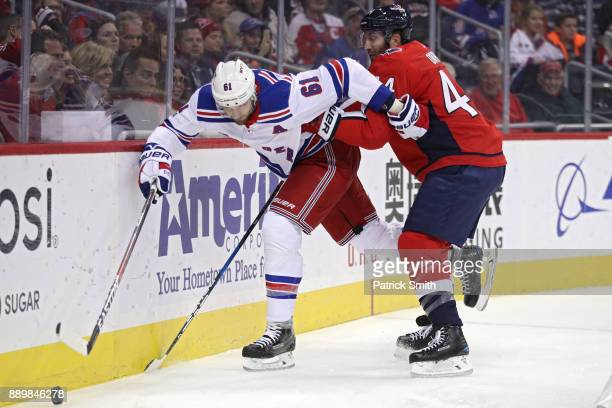 Rick Nash of the New York Rangers skates past Brooks Orpik of the Washington Capitals during the first period at Capital One Arena on December 08...