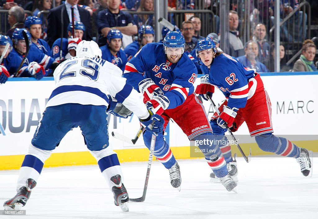 <a gi-track='captionPersonalityLinkClicked' href=/galleries/search?phrase=Rick+Nash&family=editorial&specificpeople=202196 ng-click='$event.stopPropagation()'>Rick Nash</a> #61 of the New York Rangers skates under pressure by <a gi-track='captionPersonalityLinkClicked' href=/galleries/search?phrase=Brendan+Mikkelson&family=editorial&specificpeople=2125699 ng-click='$event.stopPropagation()'>Brendan Mikkelson</a> #29 of the Tampa Bay Lightning at Madison Square Garden on February 28, 2013 in New York City. The Rangers defeat the Lightning 4-1.