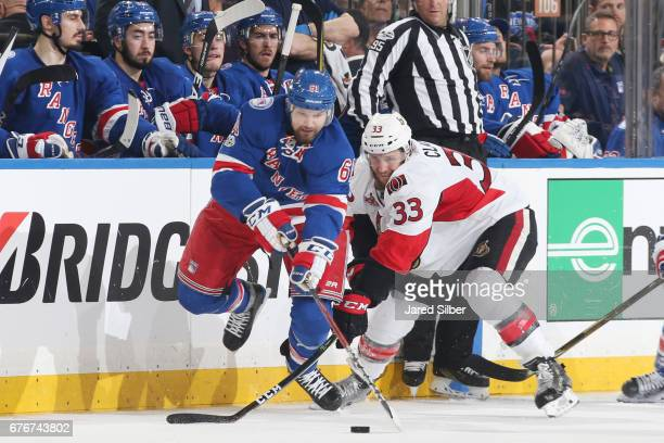 Rick Nash of the New York Rangers skates with the puck against Fredrik Claesson of the Ottawa Senators in Game Three of the Eastern Conference Second...