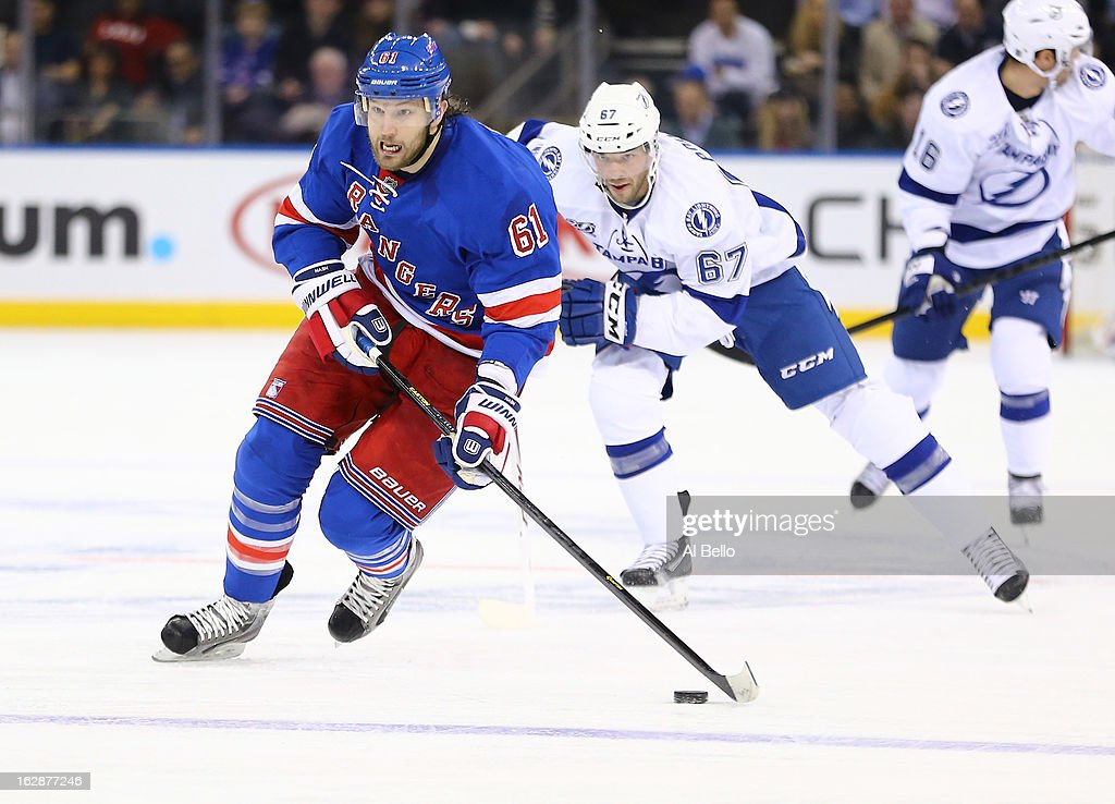 <a gi-track='captionPersonalityLinkClicked' href=/galleries/search?phrase=Rick+Nash&family=editorial&specificpeople=202196 ng-click='$event.stopPropagation()'>Rick Nash</a> #61 of the New York Rangers skates with the puck against the Tampa Bay Lightning during their game at Madison Square Garden on February 28, 2013 in New York City.