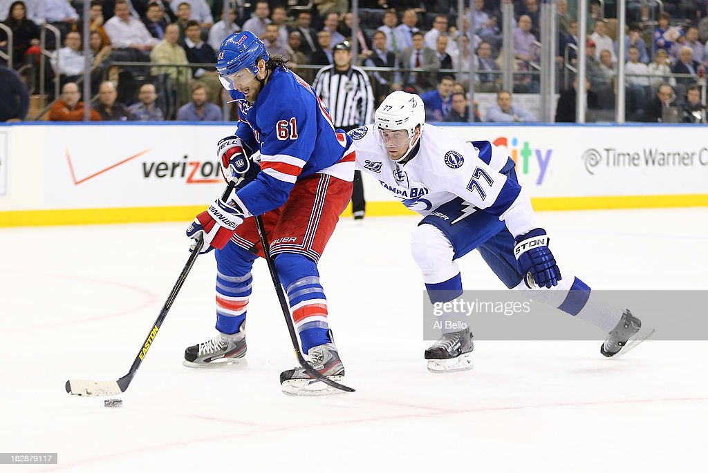 <a gi-track='captionPersonalityLinkClicked' href=/galleries/search?phrase=Rick+Nash&family=editorial&specificpeople=202196 ng-click='$event.stopPropagation()'>Rick Nash</a> #61 of the New York Rangers skates with the puck against <a gi-track='captionPersonalityLinkClicked' href=/galleries/search?phrase=Victor+Hedman&family=editorial&specificpeople=4784238 ng-click='$event.stopPropagation()'>Victor Hedman</a> #77 of the Tampa Bay Lightning during their game at Madison Square Garden on February 28, 2013 in New York City.