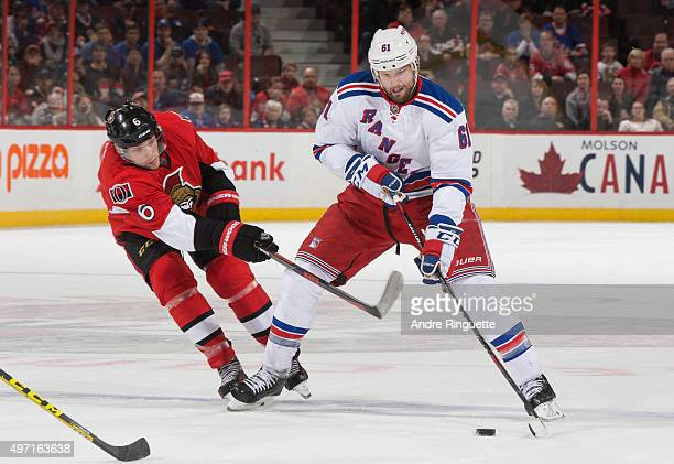 Rick Nash of the New York Rangers stickhandles the puck against Bobby Ryan of the Ottawa Senators at Canadian Tire Centre on November 14 2015 in...