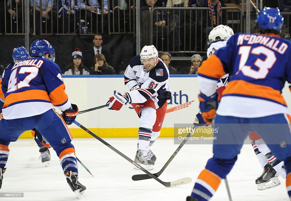 <a gi-track='captionPersonalityLinkClicked' href=/galleries/search?phrase=Rick+Nash&family=editorial&specificpeople=202196 ng-click='$event.stopPropagation()'>Rick Nash</a> #61 of the New York Rangers takes a shot on goal during the third period against the New York Islanders on January 31, 2014 at Madison Square Garden in New York City.