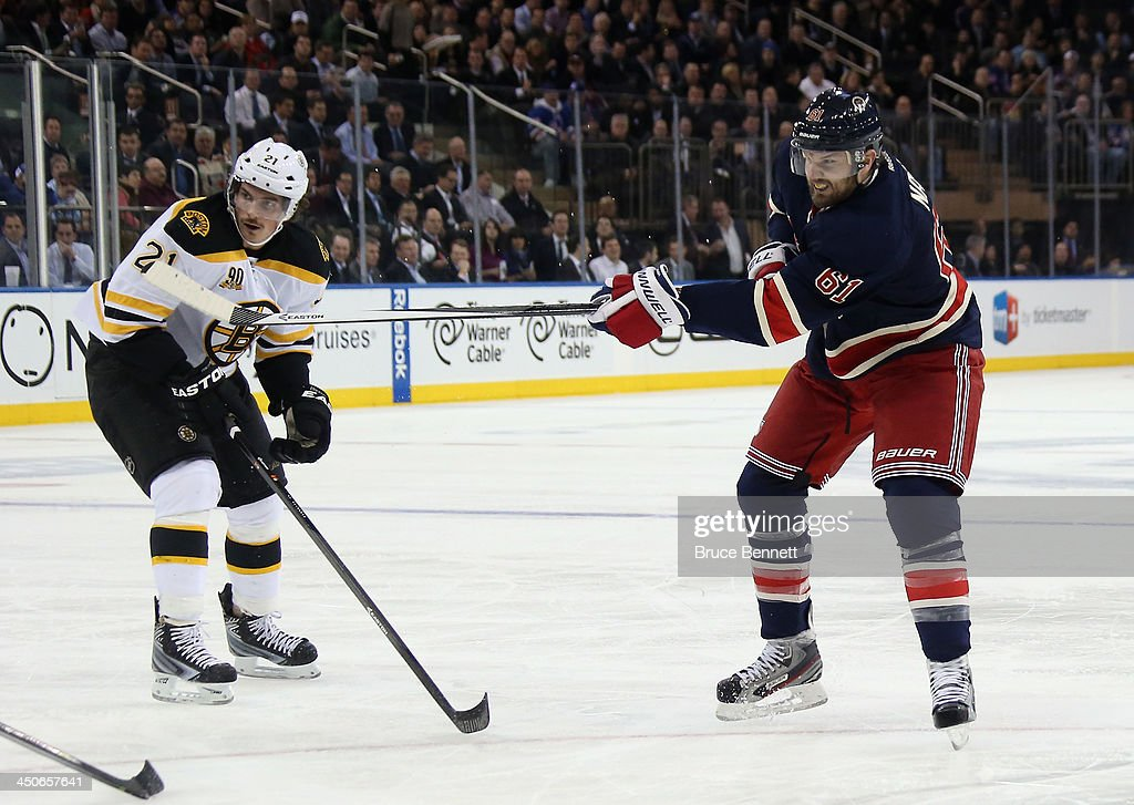 Rick Nash #61 of the New York Rangers takes the shot against the Boston Bruins at Madison Square Garden on November 19, 2013 in New York City. The Bruins defeated the Rangers 2-1.