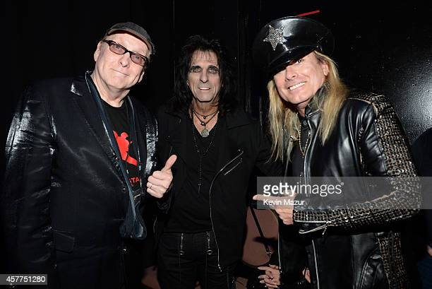 Rick Nielsen Alice Cooper and Robin Zander backstage during The 6th Annual Little Kids Rock Benefit at Hammerstein Ballroom on October 23 2014 in New...