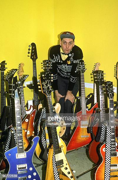 Rick Nielsen from Cheap Trick posed with some of his guitars backstage in New York in December 1978