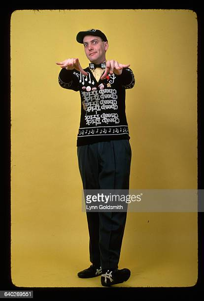 Rick Nielsen guitarist for the rock group Cheap Trick poses in one of his characteristic sweaters