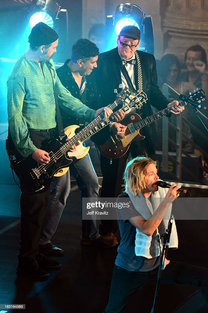 Rick Nielsen, Krist Novoselic, Pat Smear and Taylor Hawkins performs with the Sound City Players on 'Jimmy Kimmel Live' on March 5, 2013 in Hollywood, California.
