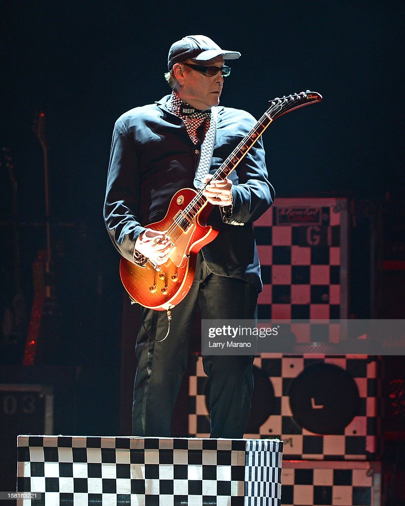 <a gi-track='captionPersonalityLinkClicked' href=/galleries/search?phrase=Rick+Nielsen&family=editorial&specificpeople=214720 ng-click='$event.stopPropagation()'>Rick Nielsen</a> of Cheap Trick performs at BB&T Center on December 9, 2012 in Sunrise, Florida.