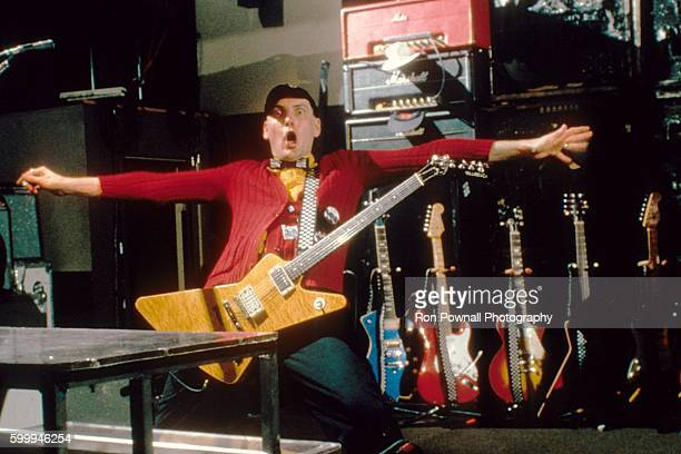 Rick Nielsen of the Rock group Cheap Trick performs at The Paradise on June 9 1978 in Boston Massachusetts