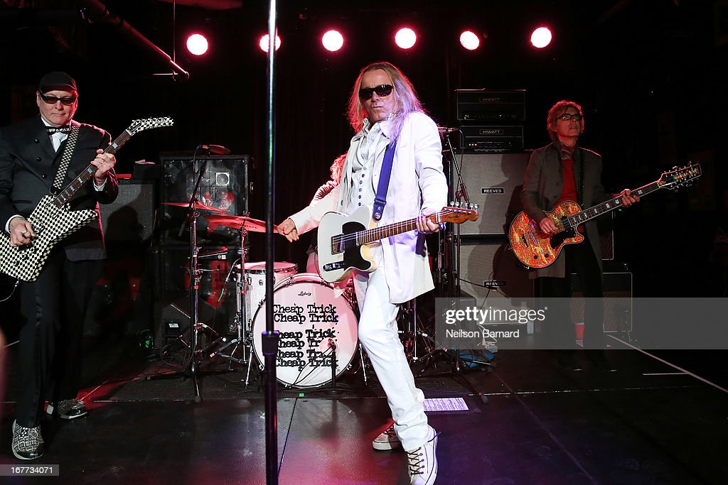 Rick Nielsen Robin Zander and Tom Petterson of the band Cheap Trick perform on stage during the 35th Anniversary of Cheap Trick at Budokan at the...