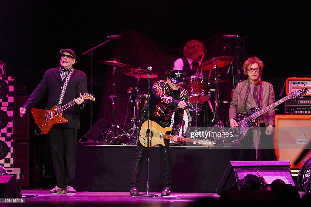 Rick Nielsen, Robin Zander, Daxx Nielsen and Tom Petersson of Cheap Trick perform at BB&T Center on December 9, 2012 in Sunrise, Florida.
