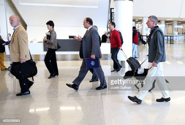 Rick Oberst walks therapy dog named Donner inside Terminal 2 at San Francisco International Airport on December 3 2013 in San Francisco California...
