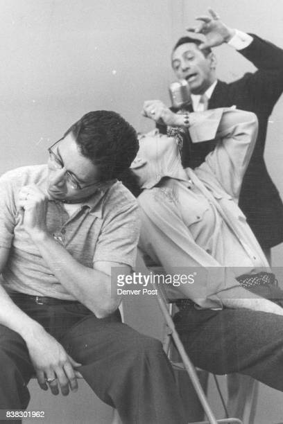 Rick Padilla and Alan Boxer right seated appear to be enjoying ice cream cones which Dr Arthur Ellen told them they had in their hands Boxer is...