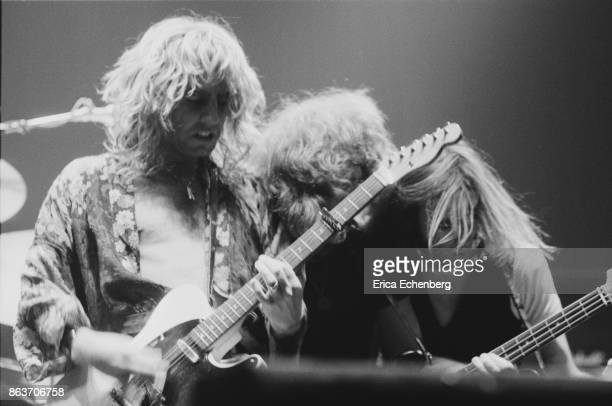 Rick Parfitt Alan Lancaster and Francis Rossi of Status Quo perform on stage at Bingley Hall Stafford January 9th 1977
