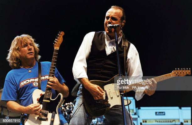 Rick Parfitt and Francis Rossi from Status Quo on stage in Hyde Park where they joined forces with The Beach Boys