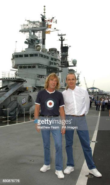 Rick Parfitt and Francis Rossi of Status Quo on the takeoff ramp of the HMS Ark Royal in Portsmouth The band staged a concert for fans and sailors to...