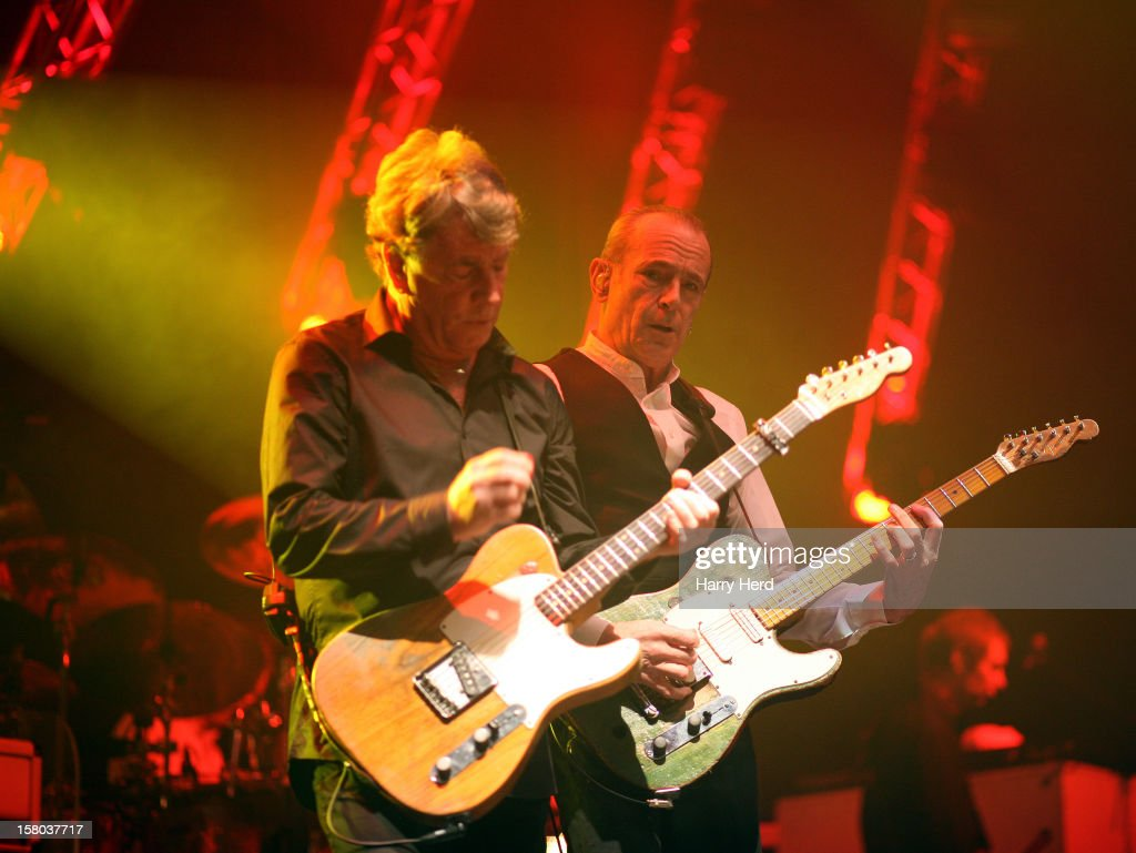 Rick Parfitt and Francis Rossi of Status Quo perform at Quofestive at the BIC on December 9, 2012 in Bournemouth, England.