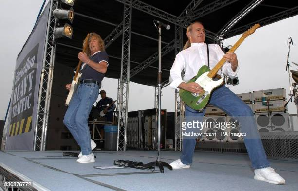 Rick Parfitt and Francis Rossi of Status Quo play for fans and sailors on board the HMS Ark Royal in Portsmouth The band staged the concert to...