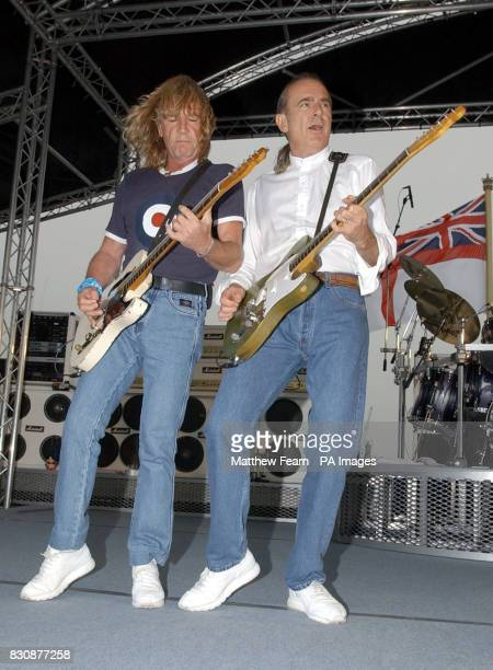 Rick Parfitt and Francis Rossi of Status Quo play on the HMS Ark Royal in Portsmouth The band staged a concert for fans and sailors to promote their...
