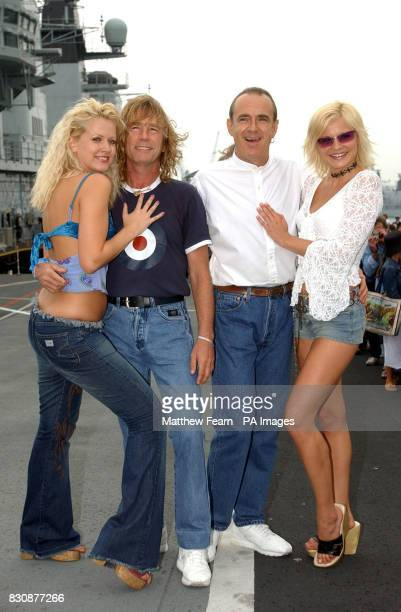 Rick Parfitt and Francis Rossi of Status Quo with two Models Prior to playing on the HMS Ark Royal in Portsmouth The band staged a concert for fans...