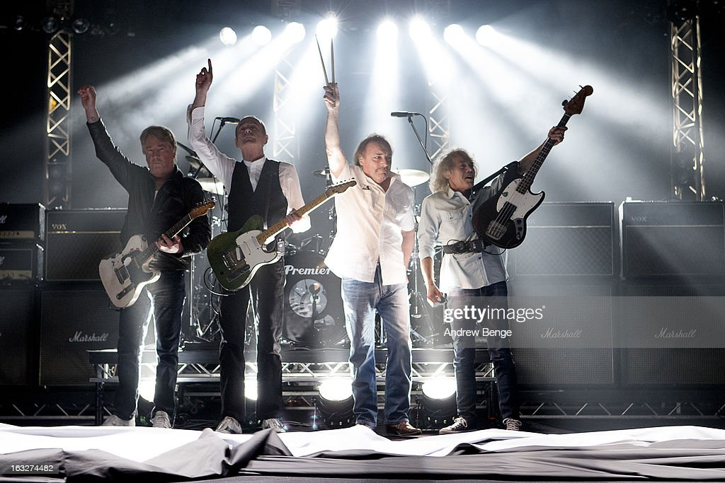 Rick Parfitt, Francis Rossi, Matt Letley and Alan Lancaster of Status Quo perform on stage in concert at Manchester Apollo on March 6, 2013 in Manchester, England.